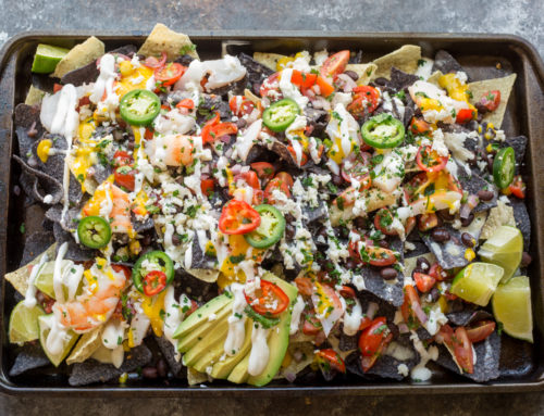 Lobster Nachos with White Queso and Sweet Mango Drizzle